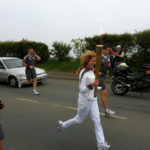 Sailor Izzy Sharpe carries Olympic torch in 2012